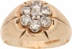 We've watched the prices for Elvis' rings drop since the economic shutdown started in 2008, but it appears that things are coming back pretty good.  This 14k gold ring with a seven-diamond cluster sold for $15,000.  The price was certainly boosted by the inclusion of a photo of Elvis wearing it on stage.