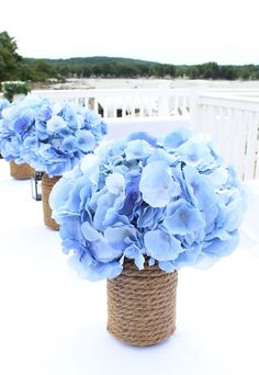 Blue faux hydrangeas make stunning wedding centerpieces. Perfect for nautical weddings too. Bring in your something blue with blue wedding flowers.