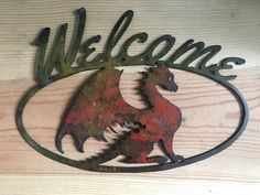 Dragon Welcome Sign for your door, interior/exterior wall, Black powder coat base on the front and clear coat both sides, This is cut out of 18 gauge steel. Measures W X H Fire Dragon, Dragon Art, Viking Decor, Wings Of Fire, How To Train Your Dragon, Porch Decorating, Mythical Creatures, Wood Carving, Fantasy Art