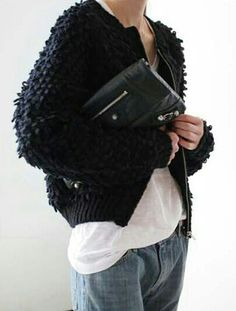 Textured black bomber, white shirt, black clutch with silver detail + loose fit light wash jeans