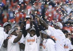 Denver Broncos players hold up the Lamar Hunt Trophy after they defeated the New England Patriots in the NFL's AFC Championship football gam...