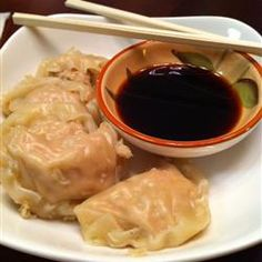 "Pork Dumplings ~ ""These tasty treats make a perfect appetizer or you can serve them as a main dish. For a main dish count on about 15 dumplings per person. Serve with hoisin sauce, hot Chinese-style mustard and toasted sesame seeds."" — Lorna"