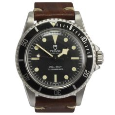 Tudor Stainless Steel Submariner Snowflake Automatic Wristwatch Ref 94010 | From a unique collection of vintage wrist watches at https://www.1stdibs.com/jewelry/watches/wrist-watches/