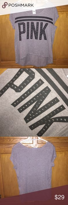 VS PINK grey tee! Size large, barely ever worn (two times tops), great condition, no rips or tears! It has an edgy, yet relaxed look with studs inside the lettering and a high/low making it seem like it's a crop top. So adorable and casual! PINK Victoria's Secret Tops Tees - Short Sleeve