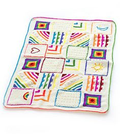 Embroidery adds a personal (and customizable!) touch to a classic baby blanket made in individual blocks. (Lion Brand Yarn)