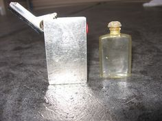 VINTAGE COTY MINI PERFUME BOTTLE IN METAL POP UP CASE (02/28/2011)