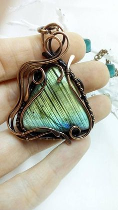 This beautiful, luxurious pendant with labradorite will be an excellent addition to your image. The pendant can be worn with a shirt of white or black or with a dress. Made of copper wire and natural stone. Patinated, polished and coated with anti-allergic varnish. A suede cord is