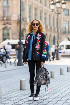 Paris street style: sneakers and sleek minimalism. Elina Halimi, buyer and artistic director, wears a KTZ jacket, Balmain shirt, J Brand pants, Linda Farrow sunglasses, Chanel bag, and Nike x Ricardo Tisci shoes.
