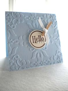 This mini card is 3x3 and is embossed with a wallpaper texture plate.  I added a hand stamped hello with craft pearls, a mini clothespin and a small white ribbon.  Great for just saying hello.