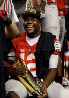 Ohio State's Cardale Jones holds the championship trophy after the NCAA college football playoff championship game against Oregon Monday, Jan. 12, 2015, in Arlington, Texas. Ohio State won 42-20.