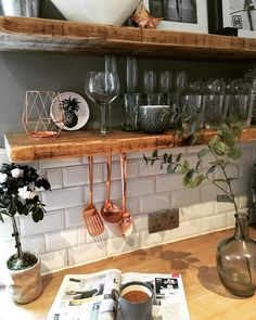 Copper and open shelves in kitchen