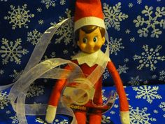 Got tangled up in this ribbon while wrapping presents. Elf on the Shelf ideas | BabyCenter Blog