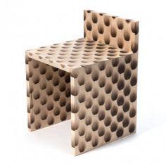 Sookhyun+Kim+burns+circles+onto+Peacock+Chair+with+a+heat+gun
