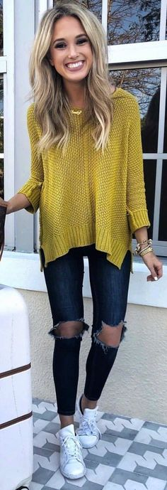 #winter #outfits yellow sweater ad distressed black jeans. Pic by @champagneandchanel.