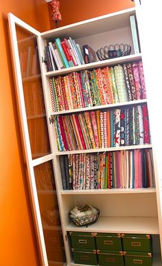 How to organize fabric - mini-bolts and a bookcase with glass doors. Fabulous!