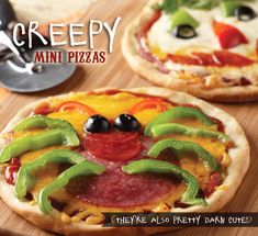 Creepy Mini Pizzas- bring some spookiness to your halloween lunch or dinner.