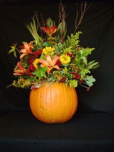 fall floral arrangements - pumpkin. Centerpiece or by doorway depending on height of flowed and size of pumpkin.