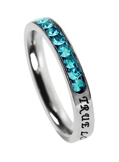 "'True Love Waits' - Princess Birthstone     	 Stainless steel petite band with cubic zirconium encased birth stones covering 1/3 of the face while remaining 2/3 reveal engraved and black enamel filled scripture ""True Love Waits - 1 Timothy 4:12. """