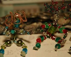 Beaded Wild Women - love 'em! Hope to learn to make them Saturday.