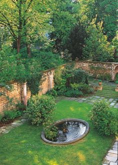 private-gardens-of-paris-gardenista An oval fountain lends a picturesque tranquility behind a family mansion in the 7th Arrondissement.