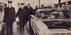 Elvis march 7 1960 back in Memphis , in a police car on his way to Graceland.