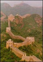 The Great Wall of China (begun c. 214 B.C.), designed specifically as a defense against nomadic tribes, has large watchtowers that could be called buildings. It was erected by Emperor Ch'in Shih Huang Ti and is 1,400 mi long. Built mainly of earth and stone, it varies in height between 18 and 30 ft.