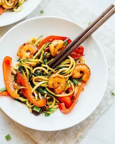 EBF version of Friday night takeout = zucchini noodle shrimp lo mein with mushrooms bell pepper and fresh ginger.  This dish is loaded with flavor #paleo #glutenfree #lowcarb and takes only 20 minutes to whip up!  Get the recipe for this one skillet wonder #ontheblog today.