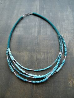 Shades of tiny teal ceramic beads and some by zsazsazsu1963