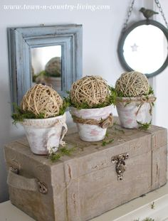 Create a cute vignette by transforming clay pots with a coat of white wash and then embellish them with lace, burlap, buttons, and more. Easy and inexpensive!
