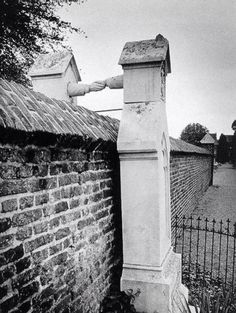 The tomb with the hands (Roermond, Netherlands)  In 1888 a Protestant could not be buried in the Catholic cemetery of his wife. Because the Catholic and Protestant part portion was separated by a high wall, this solution was devised.