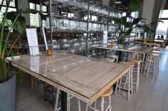 Our #barnwood #doors Are Used As #tabletops With A Glass Top In This