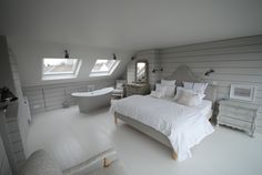 loft conversion bedroom with bath, completely panelled