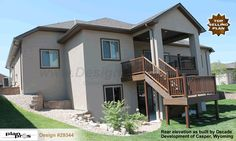 The rear elevation of #homeplan #29344 the Hester as built by Decade Homes in Casper Wyoming.