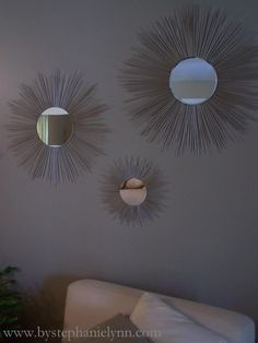 You just need a round mirror, wooden skewers, this template, and lots of hot glue.