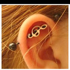 Industrial piercing, treble clef