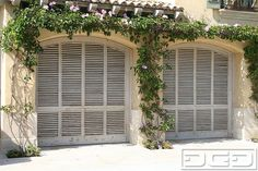 French Cottage Garage Doors in an airy, louvered style. These garage doors roll-up & are insulated. Unique, high-end French Garage Doors. Custom Garage Doors, Garage Door Design, Custom Garages, Coastal Cottage, Coastal Homes, Home Interior, Interior And Exterior, Garage Exterior, Sectional Garage Doors