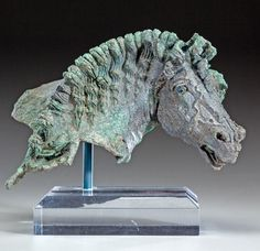 Ancient Hellenistic Bronze Horse Head Fulcrum Fragment. 1st Century BC with much of original silvering. one core-formed glass eye. This and more important ancient art on CuratorsEye.com