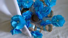 Porta guardanapo, flor de papel.    Cor: Azul claro.  Fazemos de acordo com a cor de sua festa.
