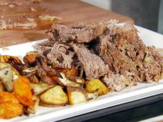 This looks like it will take a very long time to make, but it could be worth it.   Pot Roast with Roasted Root Vegetables from FoodNetwork.com