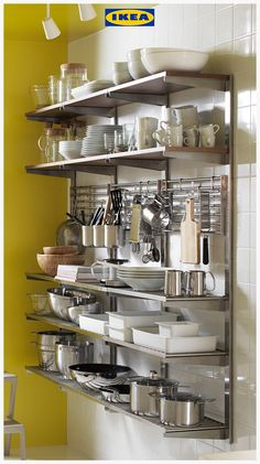 Modern Kitchen This IKEA KUNGSFORS storage solution is comprised of open shelves with an industrial finish. Ideal for a modern kitchen. - IKEA KUNGSFORS Suspension rail with shelf/wll grid Stainless steel/ash Gives you extra storage in your kitchen. Industrial Kitchen Design, Kitchen Room Design, Home Decor Kitchen, Interior Design Kitchen, Kitchen Furniture, Home Kitchens, Kitchen Ideas, Kitchen Hacks, Industrial Kitchens