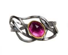 LOVE THIS!  TOURMALINE BRANCH RING #NatashaWozniakJewelry  inspiration: Japanese Meiji-era metalwork  Tree branches bend and interweave into a ring of silver. The blackened metal is reminiscent of the classic Japanese traditions in metalwork. A rose-cut bright tourmaline is framed in gold and nestled within the branches.