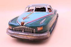 "Yonezawa ""De Luxe Car"" Cadillac style sedan, vintage tin litho metal toy car by TintageCars on Etsy https://www.etsy.com/listing/515793061/yonezawa-de-luxe-car-cadillac-style"