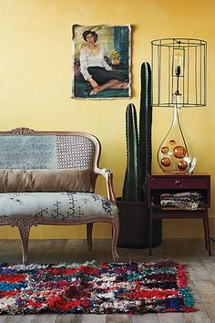 Louisa Settee, Faded Star chair - Anthropologie.com