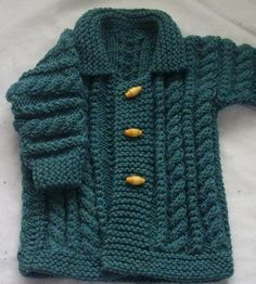 Knitting Pattern Macdara Aran Coat for Babies and Toddlers - The front and sleeves have twists and cables, while the back features a tree pattern. Three sizes
