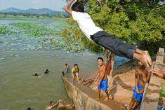 Cambodai. Chumkiri Community Forest. Children swim in lake
