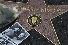 February 27, 2015 Flowers and a photo are placed on the star of actor Leonard Nimoy on on the Hollywood Walk of Fame, in Hollywood, California. after he died at his home in the Bel Air. He was 83. The photo shows Nimoy as Spock and William Shatner as Captain Kirk in during their time in the classic television series.