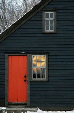 Bright colour door with traditional wood siding