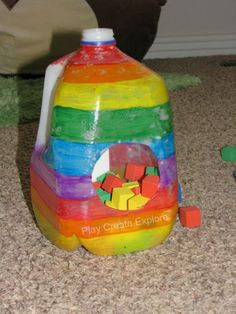 Rainbow Painted Milk Jug for play and fine motor practice