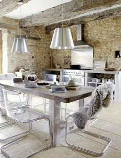 Modern rustic kitchen: Old stone walls, stainless steel stove and backsplash, rustic wood table, lucite and chrome dining chairs. Vintage House in Dordogne, France House Design, Home, Creative Kitchen Ideas, Industrial Kitchen Design, House Interior, Kitchen Dining Room, Home Kitchens, Rustic Kitchen, Kitchen Design