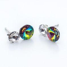 Swarovski Rivoli Earrings 6/8mm Crystal + Vitrail Medium  Dimensions: length:1,5cm stone size: 6mm and 8mm Weight ~ 1,60g ( 1 pair ) Metal : sterling silver ( AG-925) Stones: Swarovski Elements 1122 SS29 ( 6mm ) and SS39 ( 8mm )  Colour: Crystal + Vitrail Medium 1 package = 1 pair